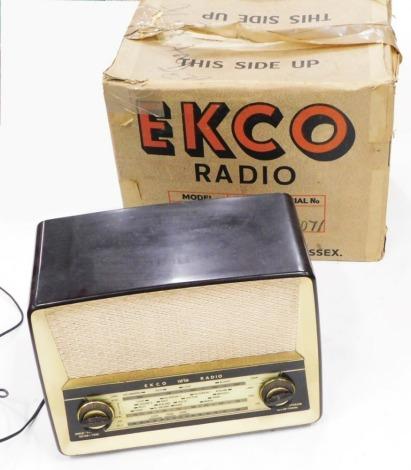 An Ekco brown and cream Bakelite radio, with original box, serial number 77071.