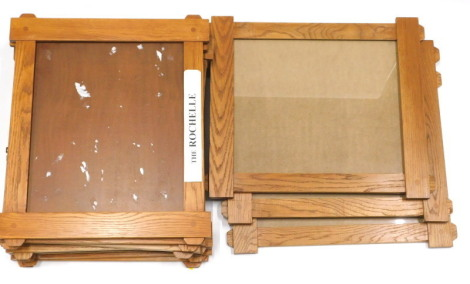 A set of ten oak photograph or picture frames, in the Arts and Crafts style, 51.5cm high, 61cm wide overall.
