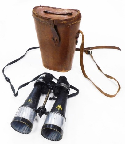 A pair of Barr and Stroud military issue binoculars, in leather case.